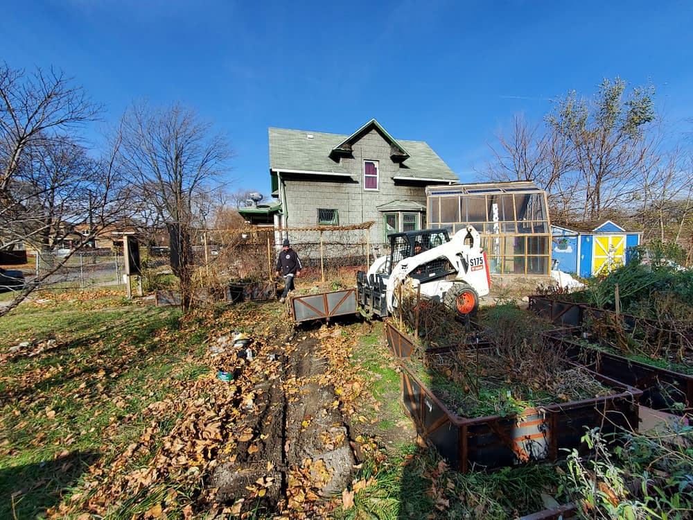 Local business helps move some raised beds